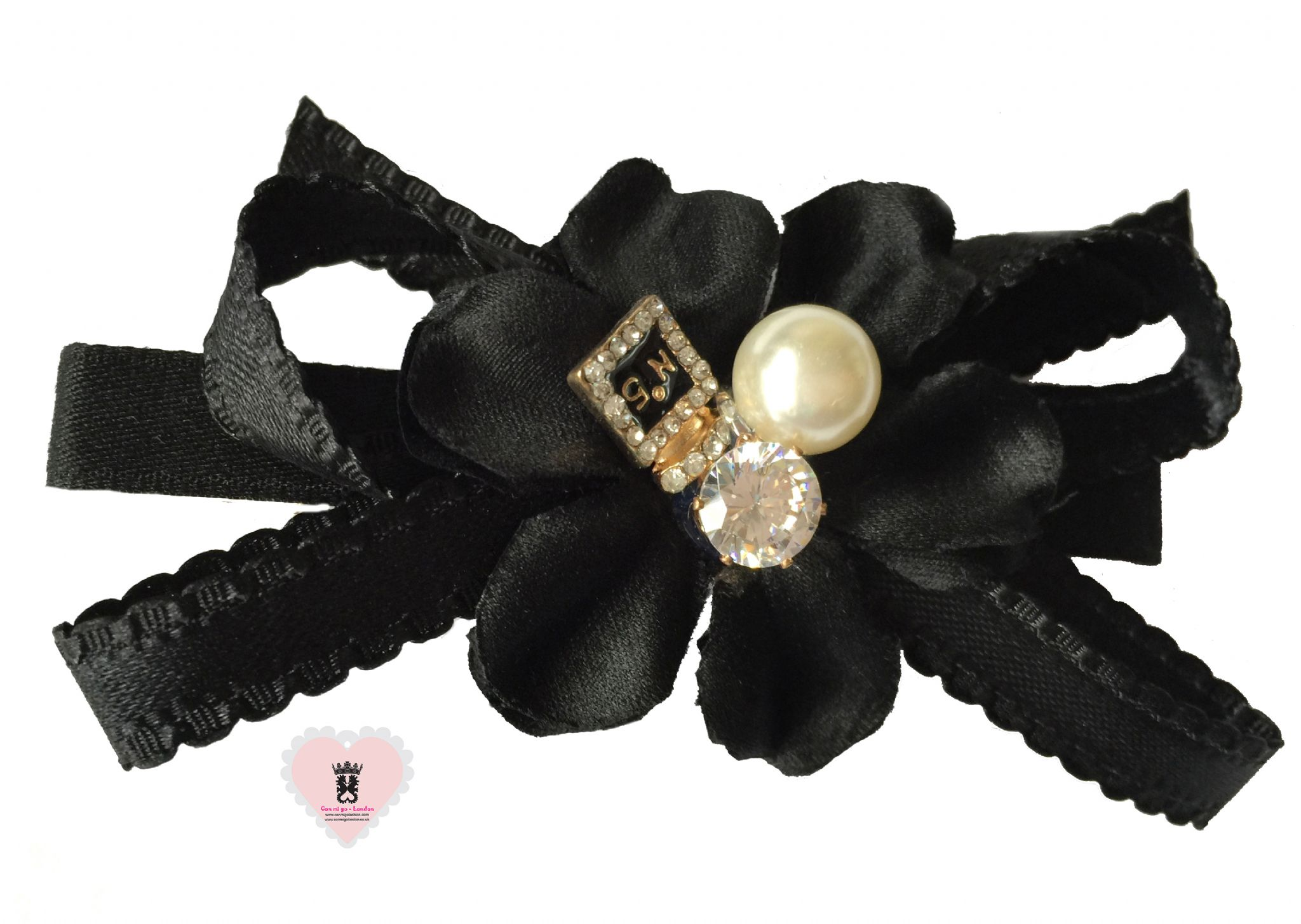 http://www.conmigolondon.co.uk/ekmps/shops/conmigo/images/1.-al0050-black-flower-with-pearl-and-sparkling-stone-hair-slide-15516-p.jpg