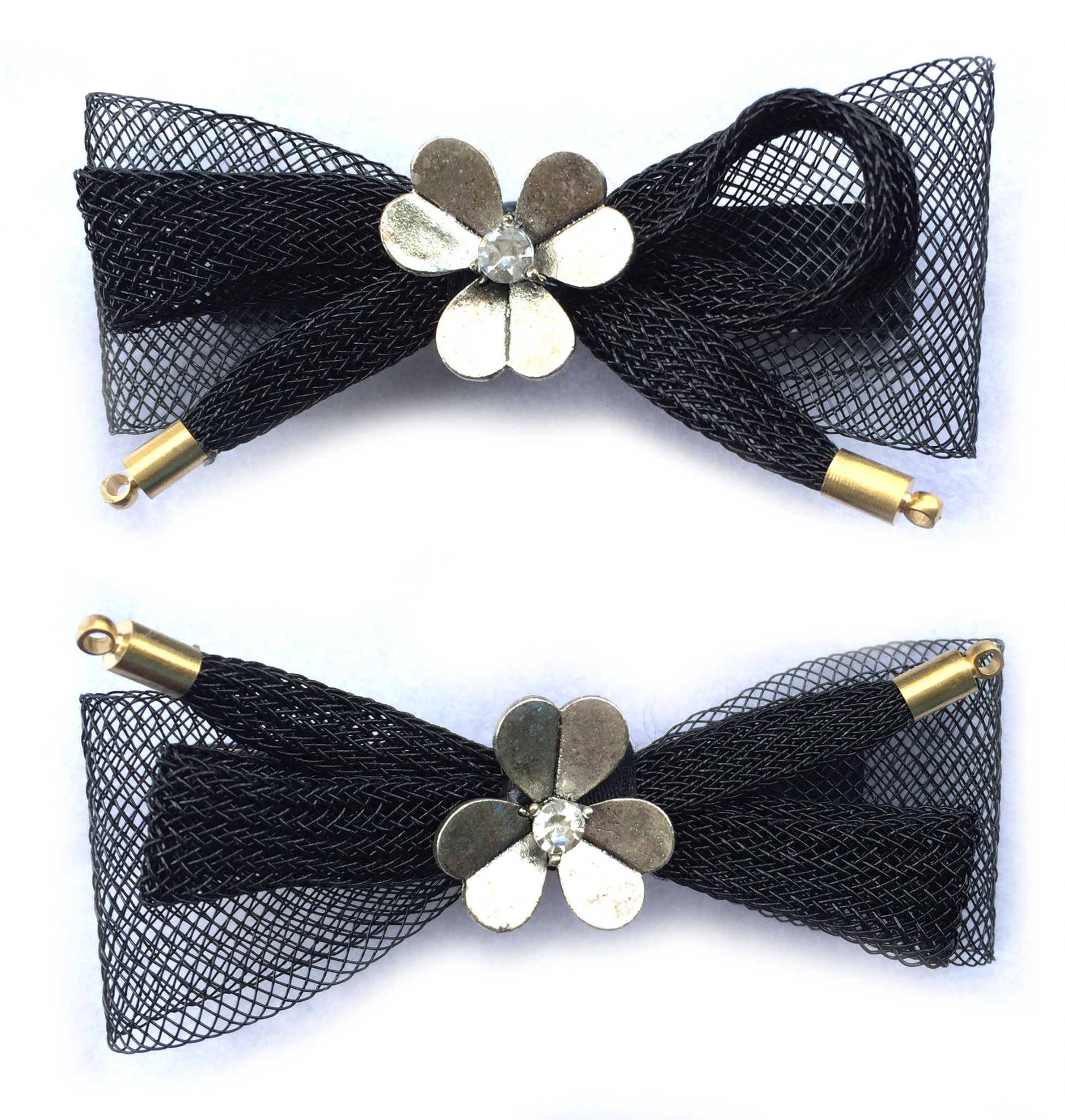 http://www.conmigolondon.co.uk/ekmps/shops/conmigo/images/1.-al0060-eye-catching-black-bow-with-silver-metal-flower-hair-slids-2-pieces-15525-p.jpg