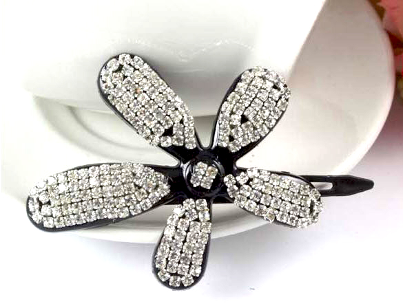 http://www.conmigolondon.co.uk/ekmps/shops/conmigo/images/cl55-flower-hair-slide-with-sparkling-sequins-silver-6082-p.jpg
