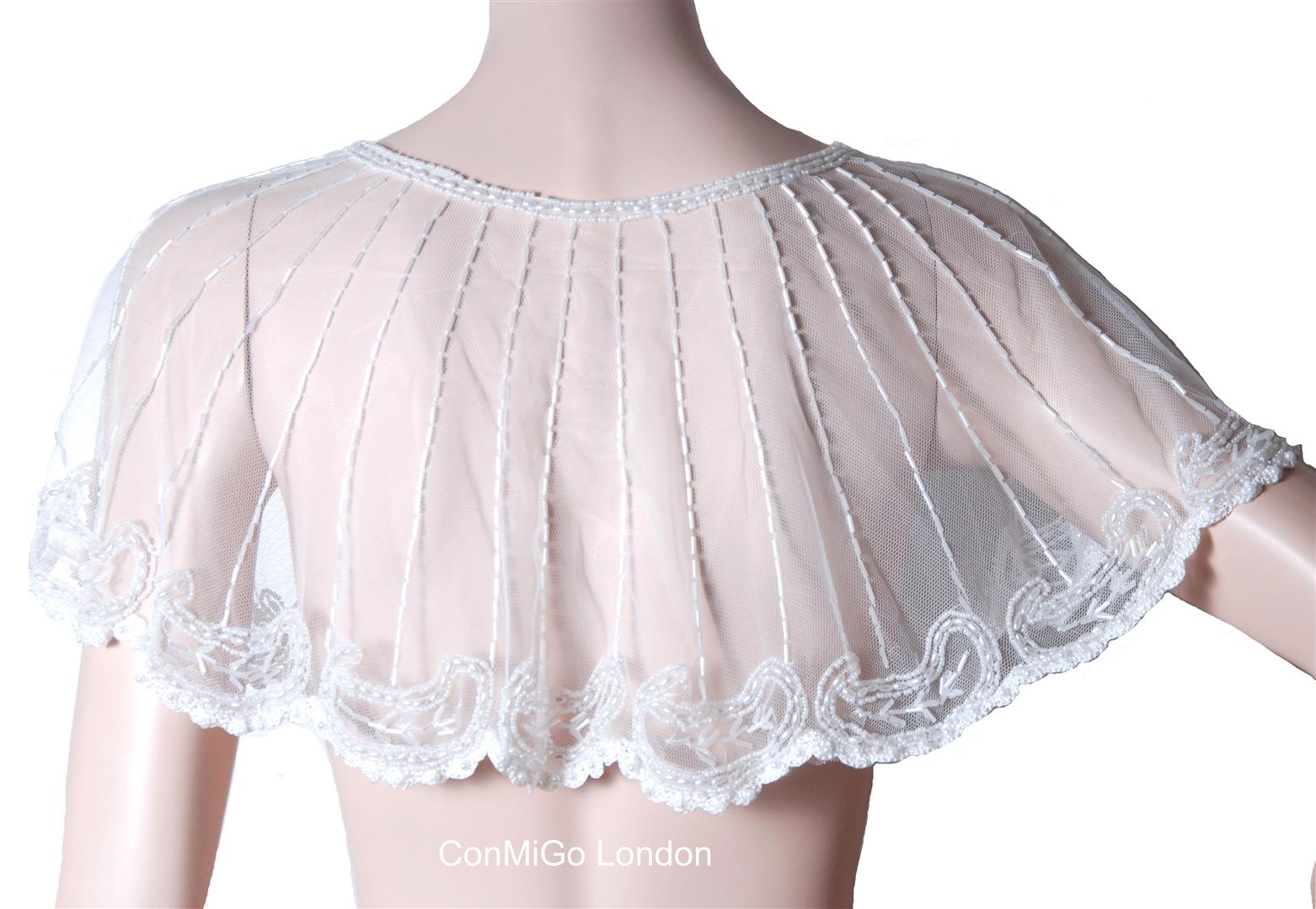 http://www.conmigolondon.co.uk/ekmps/shops/conmigo/images/conmigo-1930s-inspired-white-embroidery-mini-party-poncho-%5B2%5D-11894-p.jpg